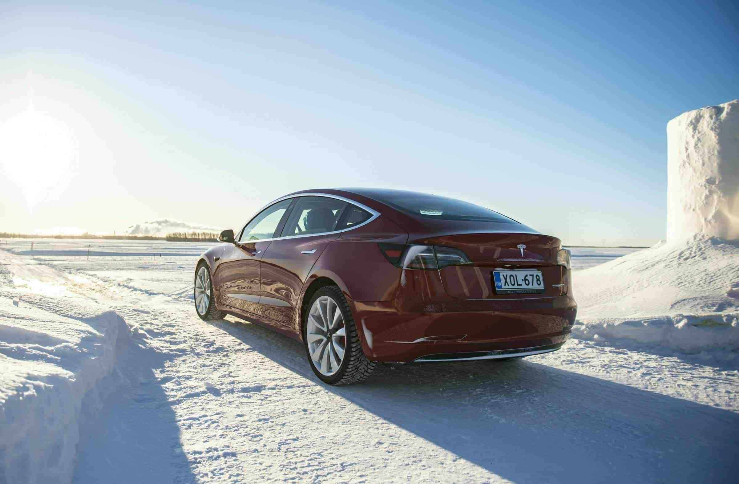 Tesla Driving on Frozen Ocean in Winter