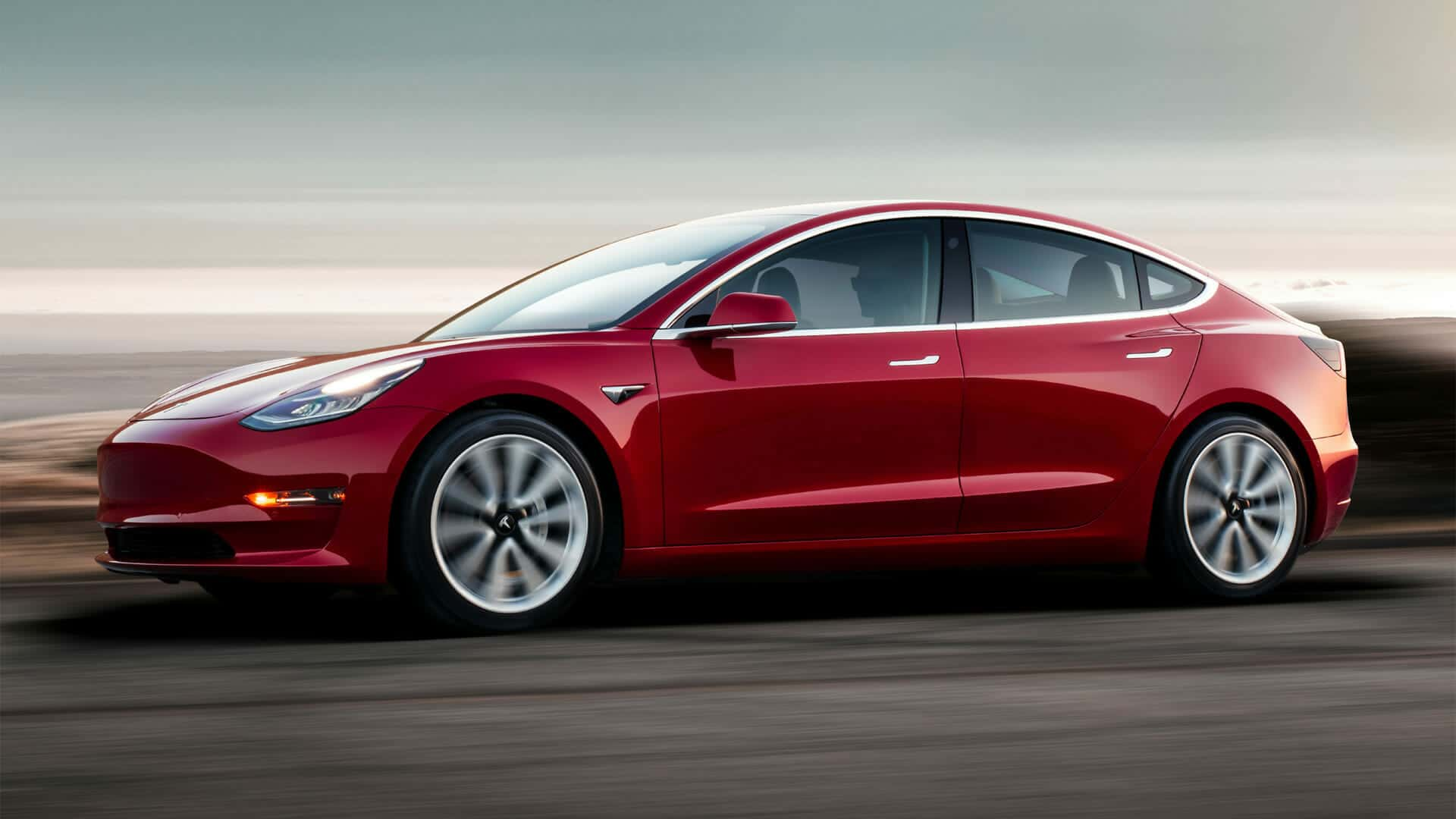 Tesla-Model-3-Red-Driving-Sunset